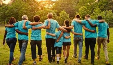 Volunteers holding around each other
